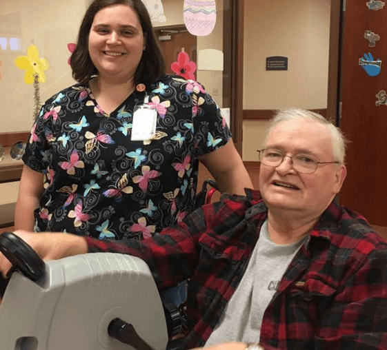 A Nurse helping a resident with exercise at the Neighbors of Dunn County.