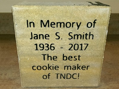 In memory of Jane S. Smith, 1936-2017, The best cookie maker of The Neighbors of Dunn County donation box.