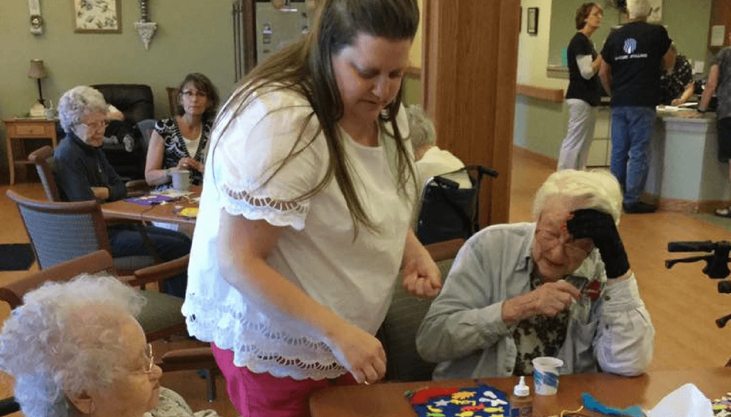 Volunteers assisting residents with crafting activity at The Neighbors of Dunn County.