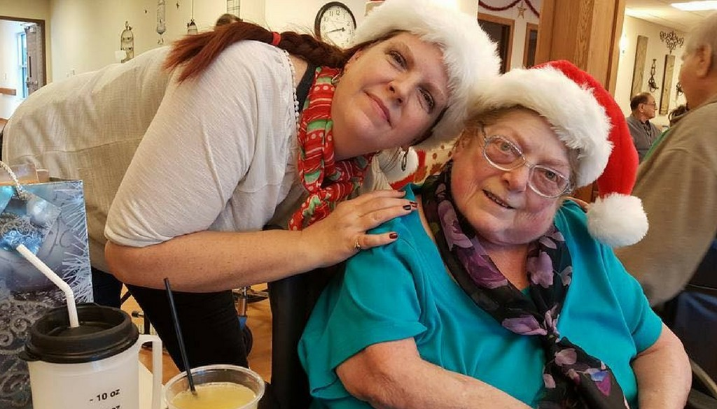 A family member visiting a resident during the Christmas Party at The Neighbors of Dunn County.
