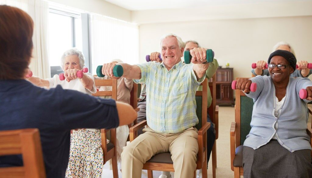 Senior citizens using light dumbells for a low impact workout.