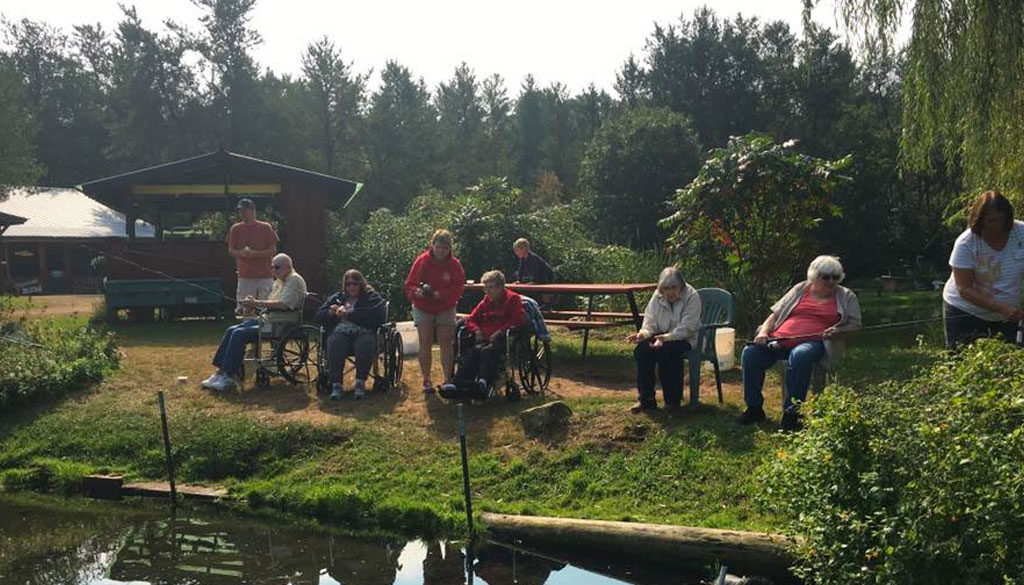 Group fishing activity at The Neighbors of Dunn County.