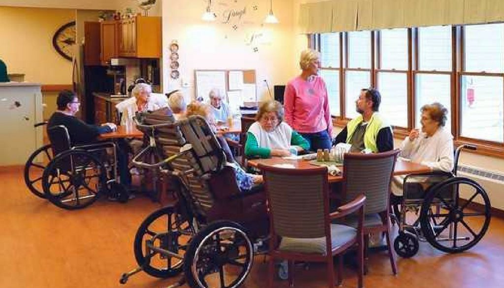 Residents sitting at tables in the lunchroom at The Neighbors of Dunn County.