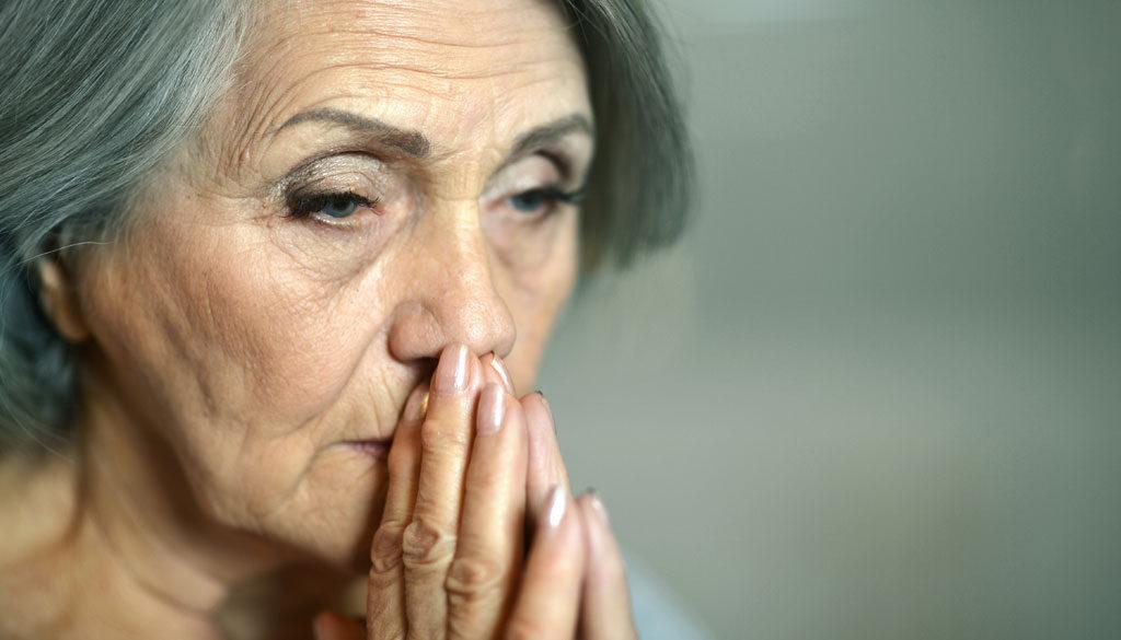 Worried looking senior citizen.