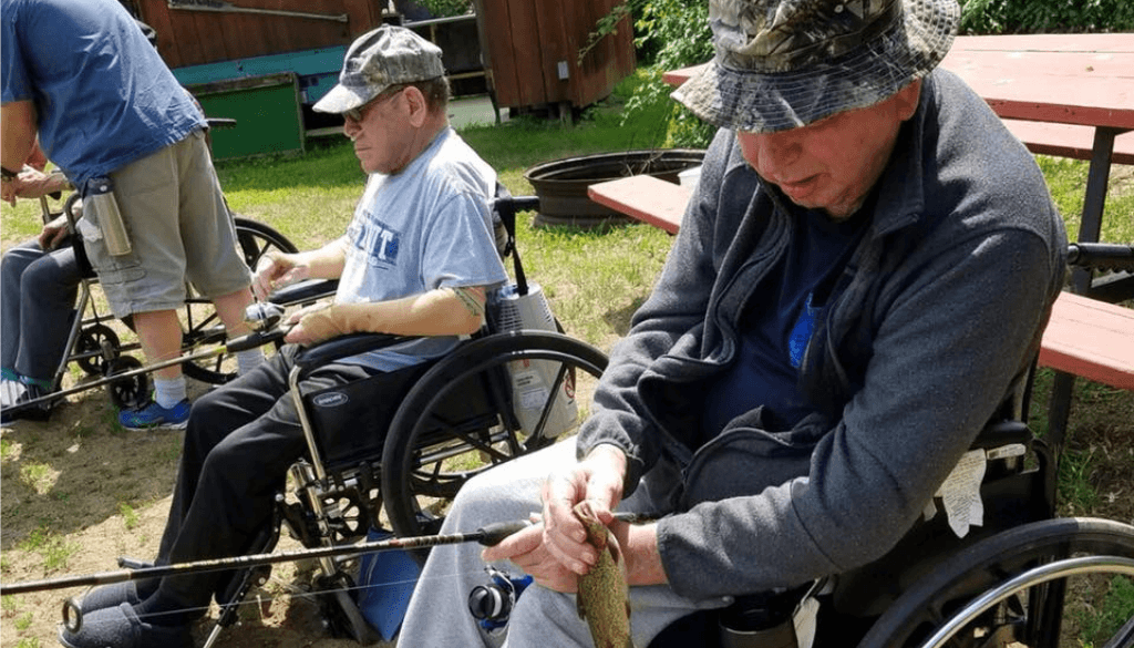 Resident from The Neighbors of Dunn County sitting in wheelchairs fishing.