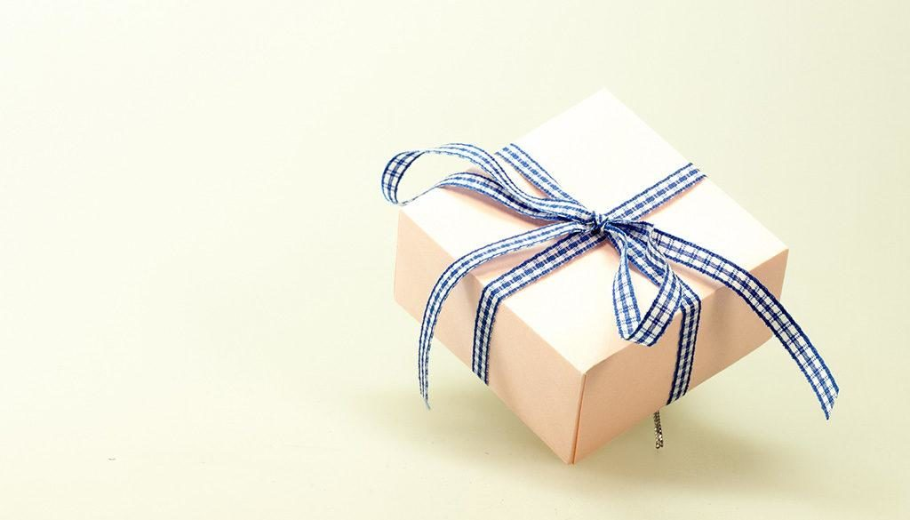 A wrapped gift box with a bowtie.