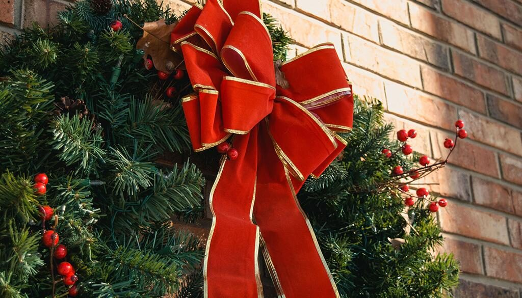 Christmas wreath hanging on a wall.