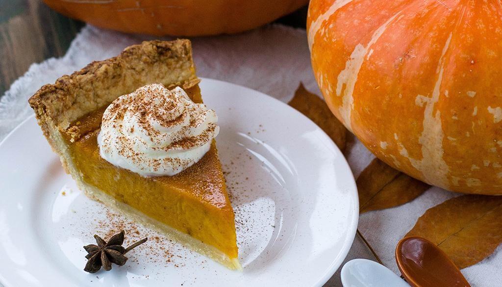 Pumpkin Pie Slice next to a pumpkin.
