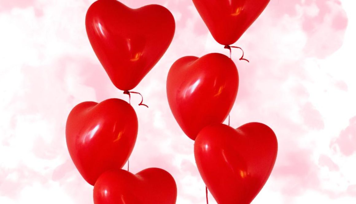 Heart balloons on a pink smokey background.