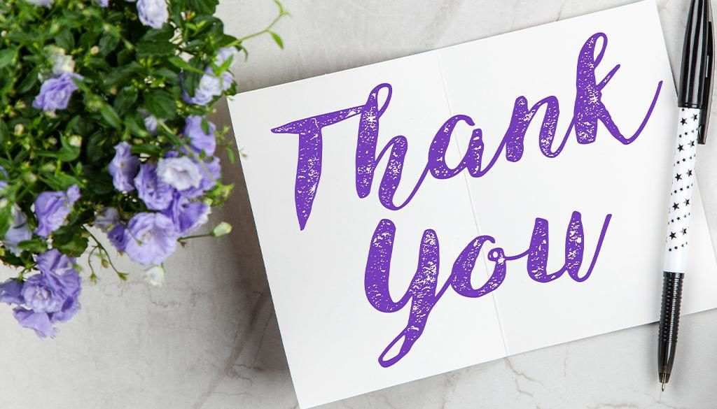 Thank you! with purple flowers.