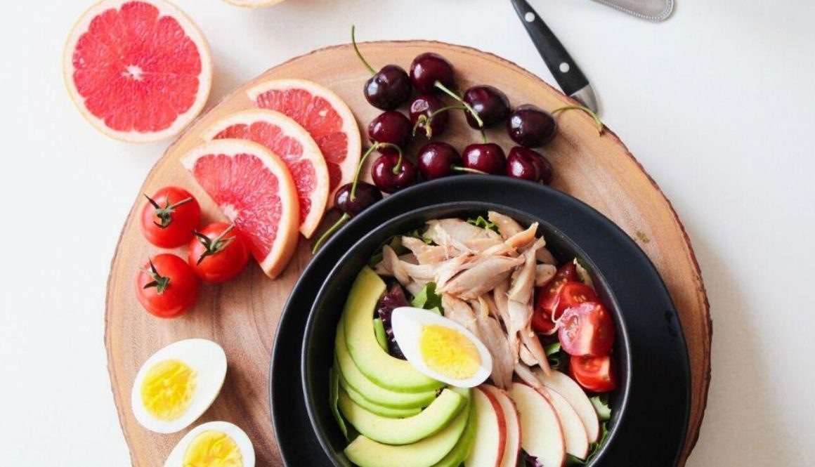 Plate full of vegetables and fruits.