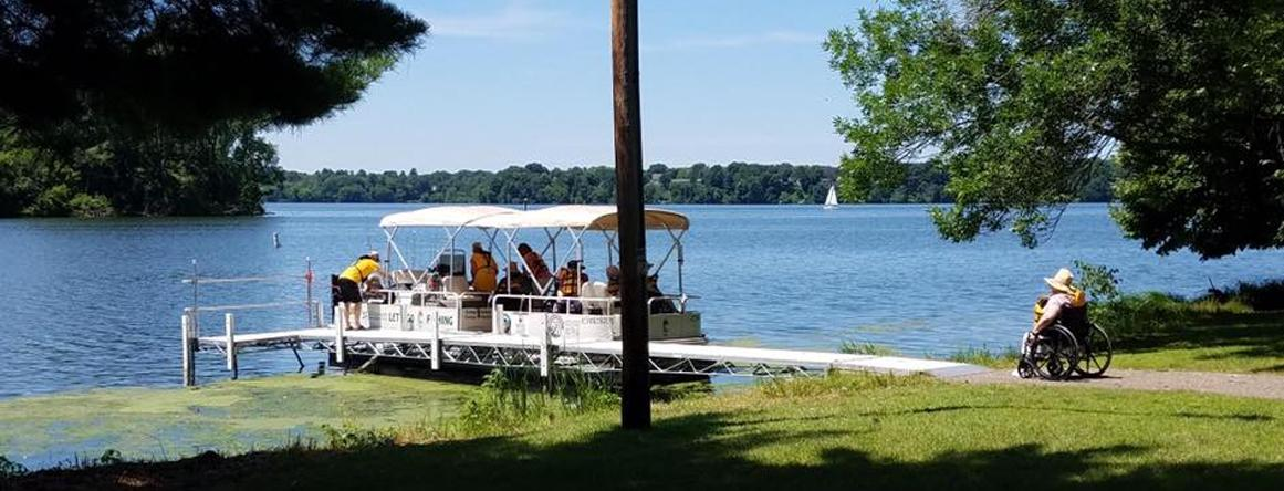 Residents of The Neighbors of Dunn County going on a pontoon ride around the lake.