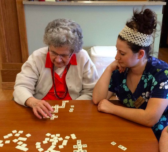 Resident and Nurse Playing Games at The Neighbors