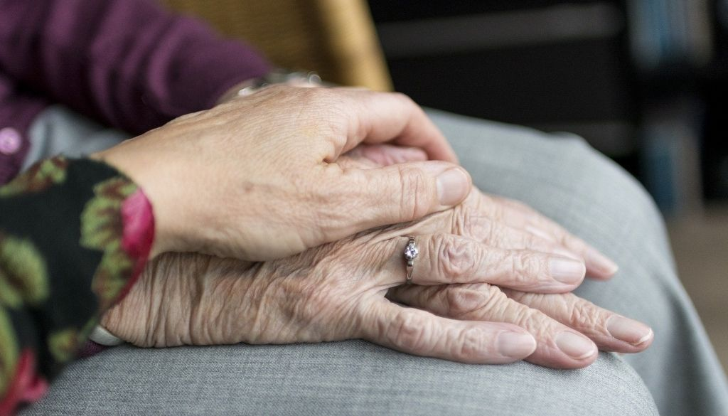 Holding hands and getting help for elders.
